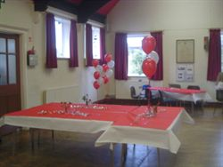 Setting for an Anniversary Party at Beoley Village Hall
